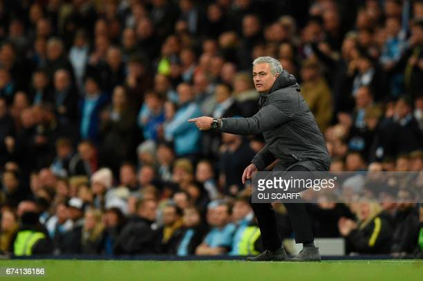 Manchester United's Portuguese manager Jose Mourinho gestures on the touchline during the English Premier League football match between Manchester...