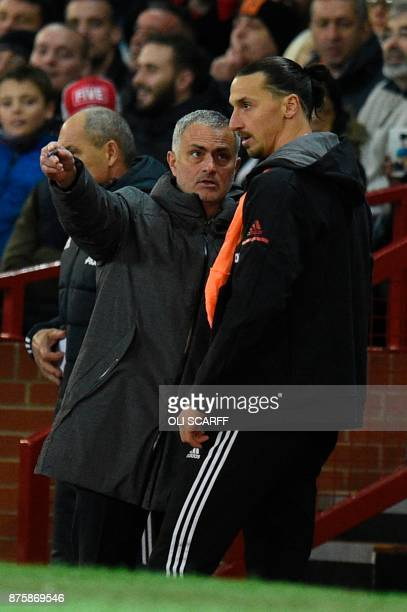 Manchester United's Portuguese manager Jose Mourinho gives instructions to Manchester United's Swedish striker Zlatan Ibrahimovic before Manchester...