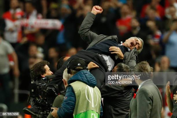 Manchester United's Portuguese manager Jose Mourinho is thrown in the air by his staff after the UEFA Europa League final football match Ajax...