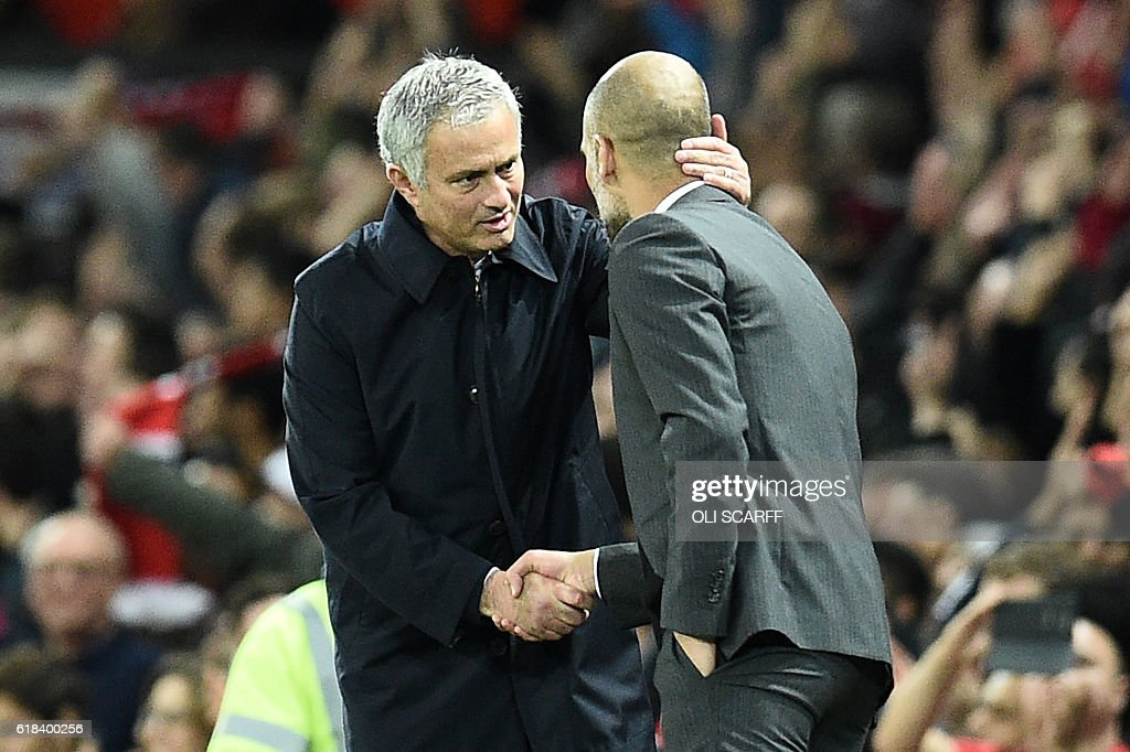 Manchester United's Portuguese manager Jose Mourinho (L) shakes hands with Manchester City's Spanish manager Pep Guardiola after the EFL (English Football League) Cup fourth round match between Manchester United and Manchester City at Old Trafford in Manchester, north west England on October 26, 2016. Manchester United won the game 1-0. / AFP / Oli SCARFF / RESTRICTED TO EDITORIAL USE. No use with unauthorized audio, video, data, fixture lists, club/league logos or 'live' services. Online in-match use limited to 75 images, no video emulation. No use in betting, games or single club/league/player publications. /