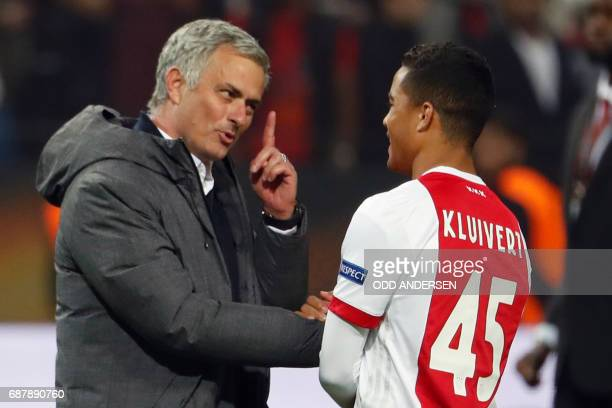 Manchester United's Portuguese manager Jose Mourinho spaeks with Ajax Dutch forward Justin Kluivert after the UEFA Europa League final football match...