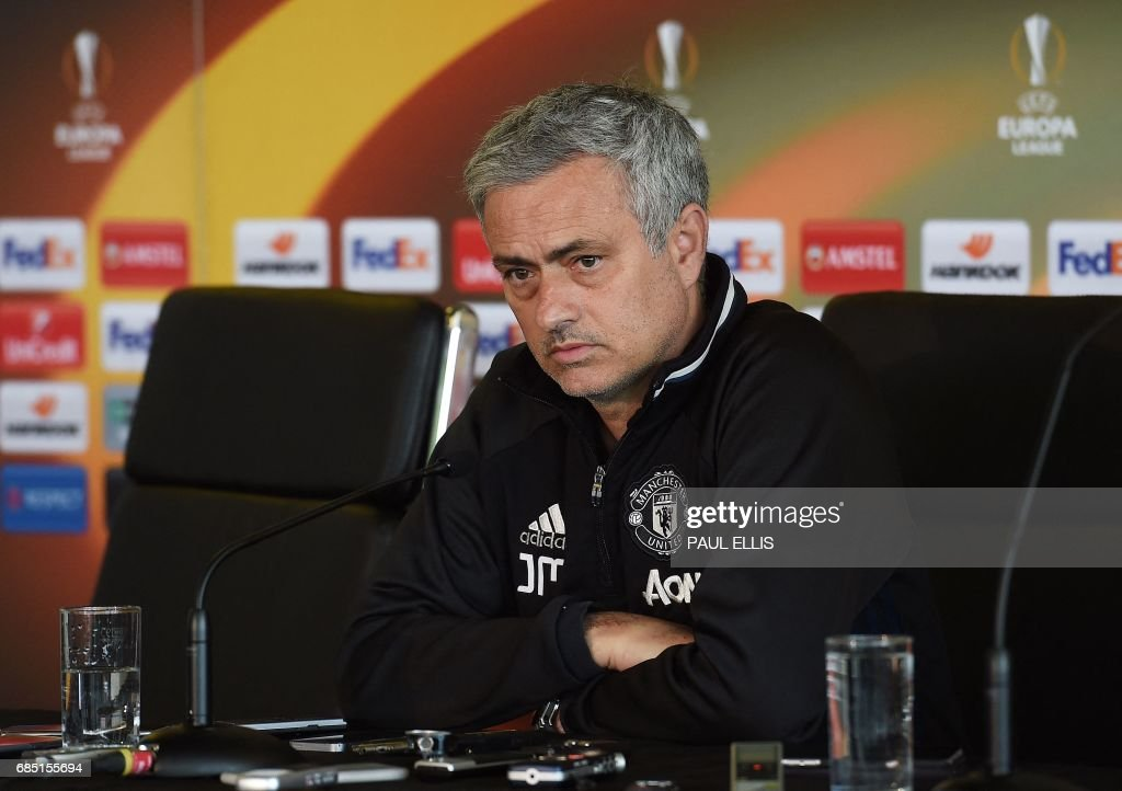 Manchester United's Portuguese manager Jose Mourinho speaks to members of the media at a press conference, part of a media open day at the club's training complex near Carrington, west of Manchester in north west England on May 19, 2017, ahead of their UEFA Europa League final football match against Ajax. / AFP PHOTO / Paul ELLIS