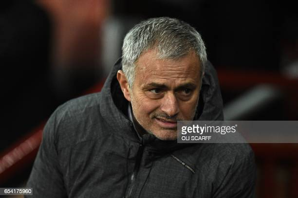 Manchester United's Portuguese manager Jose Mourinho takes his seat for the UEFA Europa League round of 16 secondleg football match between...