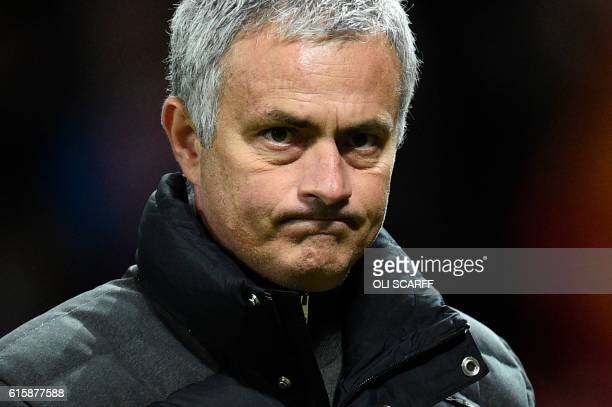 Manchester United's Portuguese manager Jose Mourinho walks on the pitch after the final whistle in the UEFA Europa League group A football match...