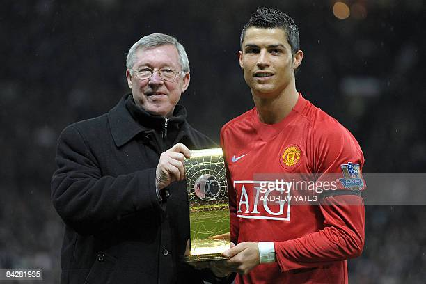 Manchester United's Portuguese midfielder Cristiano Ronaldo poses with his FIFA world player of the year trophy with Manager Alex Ferguson before the...