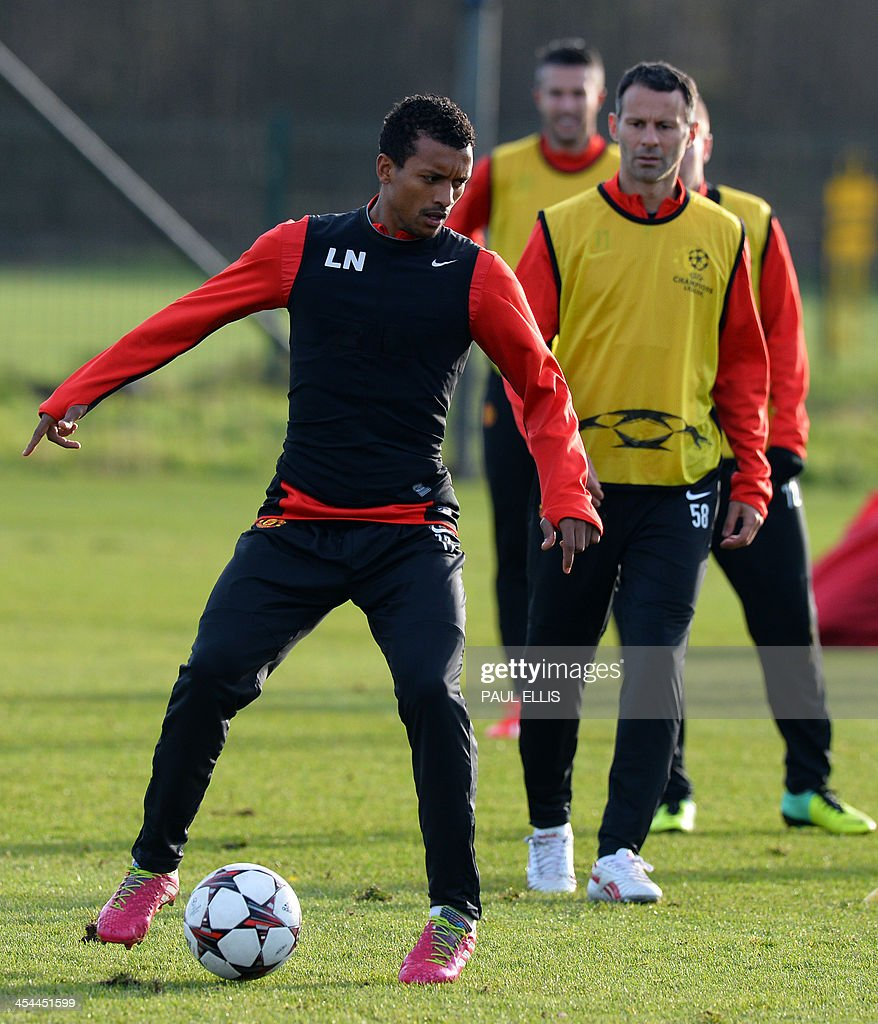 Manchester United's Portuguese midfielder Nani (L) and Manchester United's Welsh midfielder Ryan Giggs (R) take part in a training session in Manchester, north west England, on December 9, 2013 ahead of the UEFA Champions League football match between Manchester United and Shaktar Donetsk on December 10.