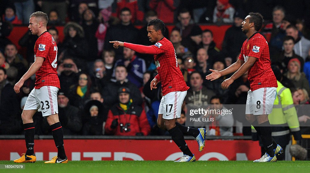 "Manchester United's Portuguese midfielder Nani (C) celebrates after scoring their first goal during the English FA Cup fifth round football match between Manchester United and Reading at Old Trafford in Manchester, north west England, on February 18, 2013. USE. No use with unauthorized audio, video, data, fixture lists, club/league logos or ""live"" services. Online in-match use limited to 45 images, no video emulation. No use in betting, games or single club/league/player publications."