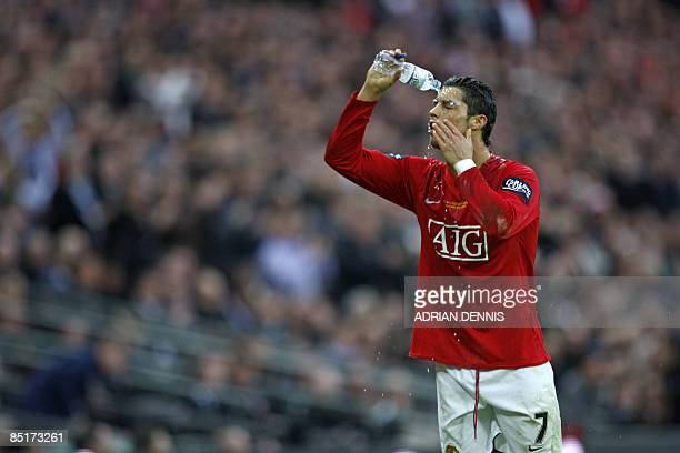 Manchester United's Portuguese player Cristiano Ronaldo pours water over his face during the 2009 Carling Cup Final against Tottenham Hotspur at...