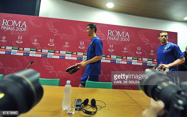 Manchester United's Portuguese winger Cristiano Ronaldo and English defender Rio Ferdinand arrive for a press conference at the Olympic stadium in...