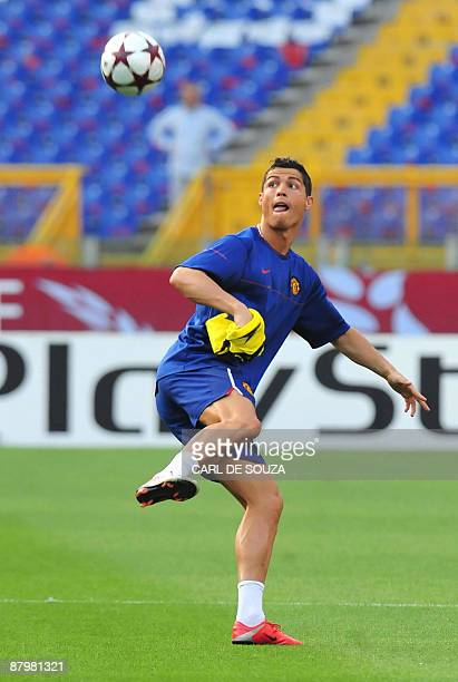 Manchester United's Portuguese winger Cristiano Ronaldo takes part in a training session at the Olympic stadium in Rome on May 26 2009 on the eve of...