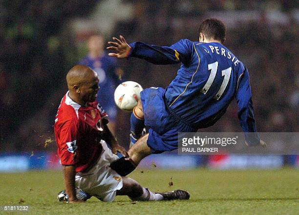 Manchester United's Quinton Fortune and Arsenal's Robin Van Persie during Carling Cup quater final clash at Old Trafford in Manchester 01 December...