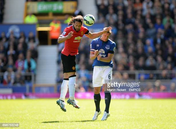 Manchester United's Radamel Falcao and Everton's Phil Jagielka battle for the ball