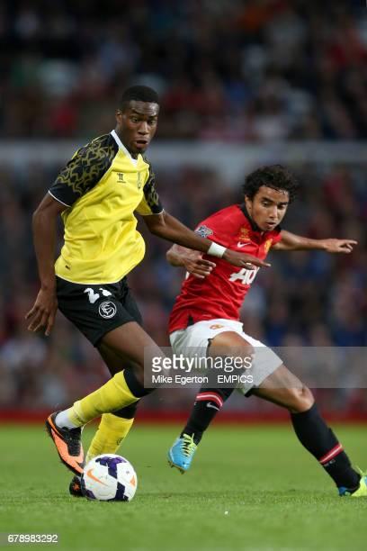 Manchester United's Rafael and Sevilla's Geoffrey Kondogbia battle for the ball