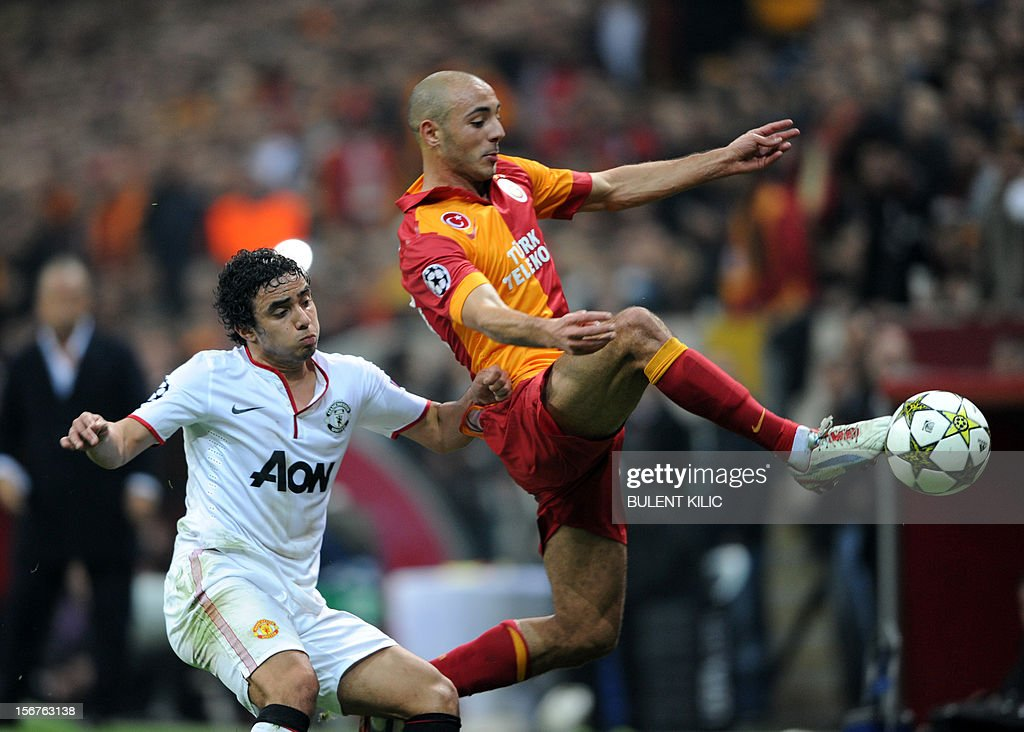 Manchester United's Rafael (L) fights for the ball with Galatasaray's Nordin Amrabat (R) on November 20, 2012 during a UEFA Champions League group football match at the Turk Telekom Arena in Istanbul. AFP PHOTO / BULENT KILIC