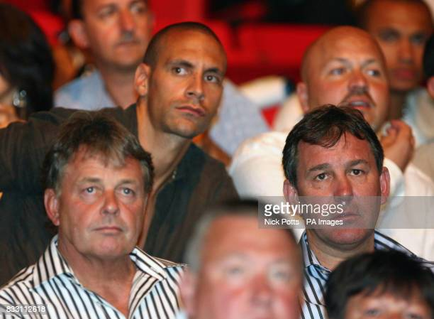 Manchester United's Rio Ferdinand and Sheffield United manager Bryan Robson watch England's Ricky Hatton defeat Mexico's Jose Luis Castillo after a...