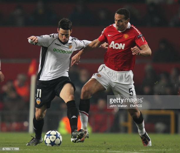Manchester United's Rio Ferdinand and Valencia's Aritz Aduriz battle for the ball