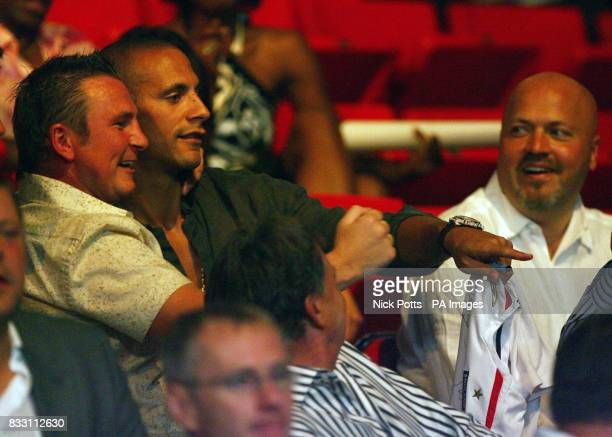 Manchester United's Rio Ferdinand watches England's Ricky Hatton defeat Mexico's Jose Luis Castillo after a fourth round stoppage at the Thomas Mack...