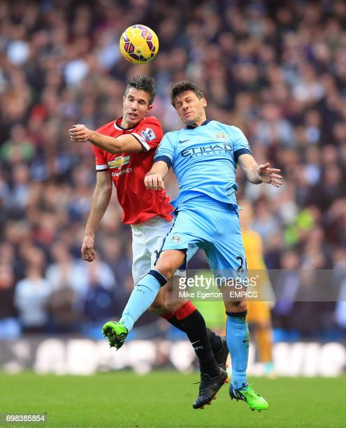 Manchester United's Robin van Persie and Manchester City's Martin Demichelis battle for the ball