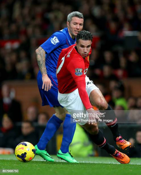 Manchester United's Robin van Persie battles for the ball with Cardiff City's Kevin McNaughton during the Barclays Premier League match at Old...