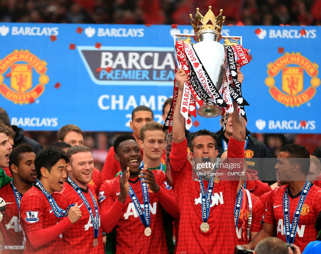 Manchester United's Robin van Persie celebrates with the Premier League trophy