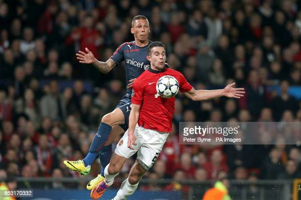 Manchester United's Robin van Persie is fouled by Olympiakos' Jose Holebas to earn his side a penalty