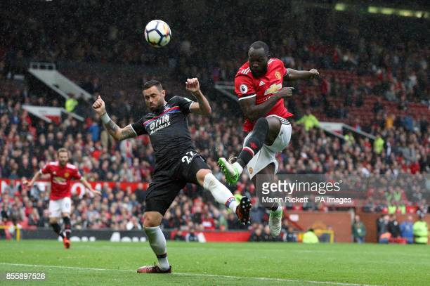 Manchester United's Romelu Lukaku and Crystal Palace's Damien Delaney battle for the ball during the Premier League match at Old Trafford Manchester