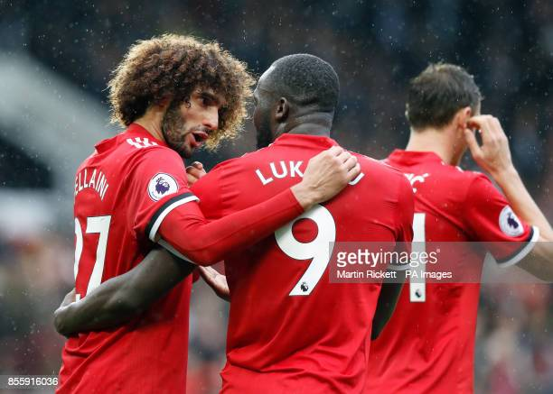 Manchester United's Romelu Lukaku celebrates scoring his side's fourth goal of the game with Marouane Fellaini during the Premier League match at Old...