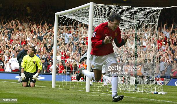 Manchester United's Ruud Van Nistelrooy celebrates scoring a penalty kick against Millwall's goalkeeper Andy Marshall during their FA Cup Final...