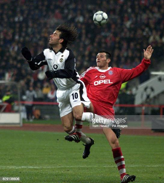Manchester United's Ruud Van Nistelrooy is challenged by Bayern Munich's Willy Sagnol during the UEFA Champions League Group A game between Bayern...