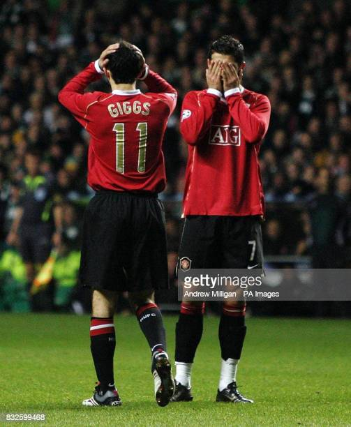 Manchester United's Ryan Giggs and Cristiano Ronaldo stand dejected after the Champions League Group F match against Celtic at Celtic Park Glasgow