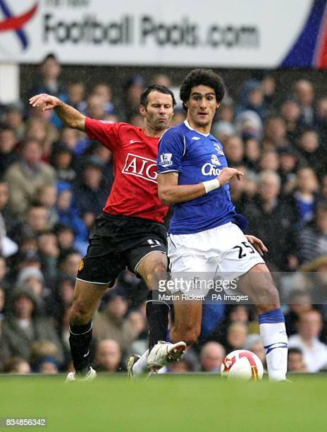 Manchester United's Ryan Giggs and Everton's Marouane Fellaini in action