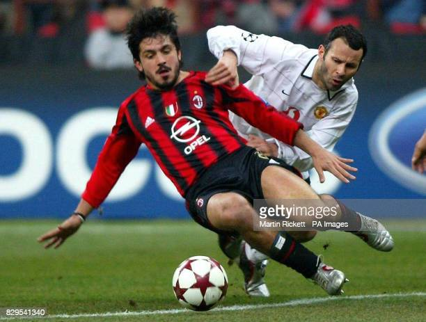 Manchester United's Ryan Giggs battles with AC Milan's Gennaro Gattuso for the ball