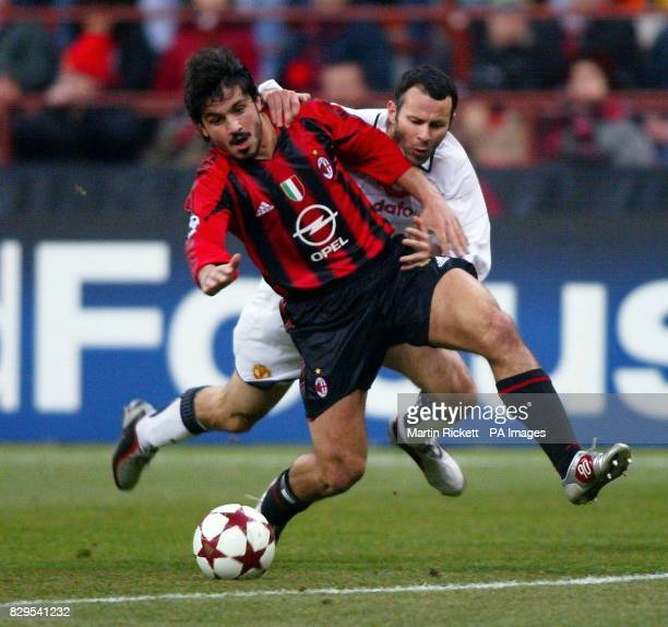 Manchester United's Ryan Giggs battles with AC Milan's Gennaro Guttuso for the ball