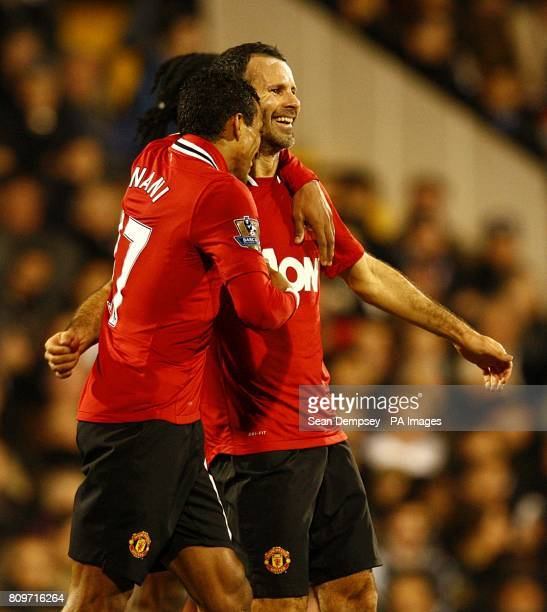 Manchester United's Ryan Giggs celebrates scoring his side's third goal of the game with teammate Luis Nani