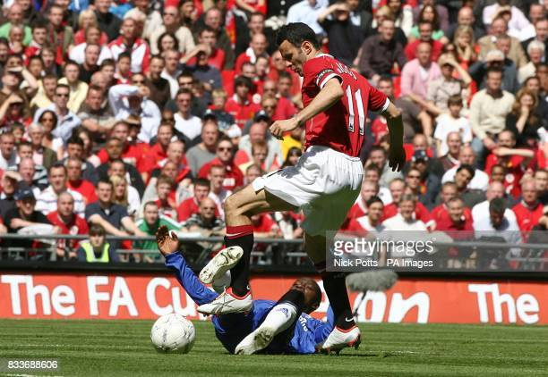 Manchester United's Ryan Giggs fouls Chelsea's Claude Makelele as they battle for the ball