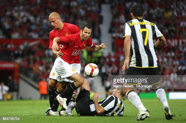 Manchester United's Ryan Giggs is challenged by Juventus' Giorgio Chiellini during the preseason friendly match at Old Trafford Manchester