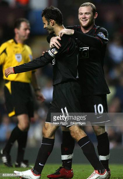 Manchester United's Ryan Giggs is congratulated by team mate Wayne Rooney after scoring his sides fourth goal of the game