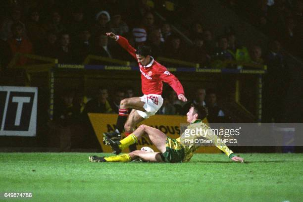 Manchester United's Ryan Giggs is tackled by Norwich City's Chris Sutton
