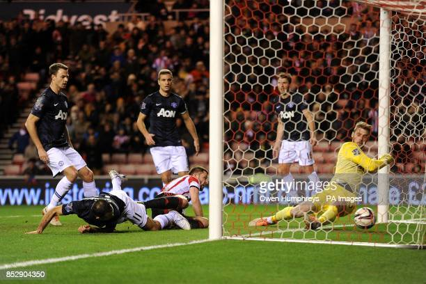 Manchester United's Ryan Giggs scores and own goal under pressure from Sunderland's Phil Bardsley