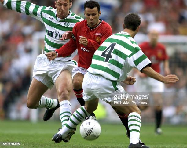 LEAGUE Manchester United's Ryan Giggs skips passed Celtic's Chris Sutton and Jackie Mcnamara during the Ryan Giggs Testimonial game at Old Trafford...