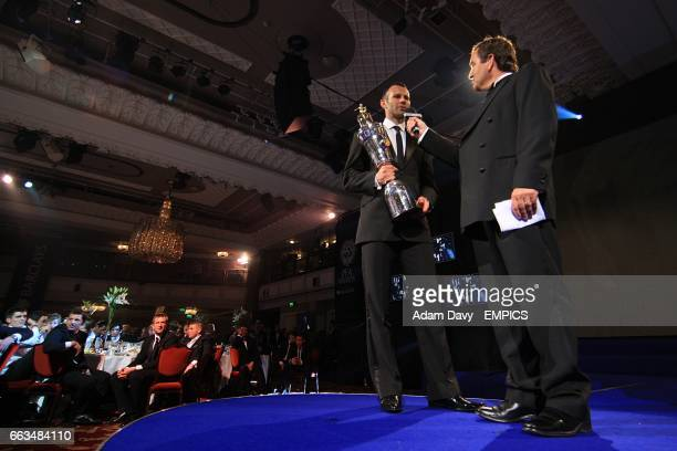 Manchester United's Ryan Giggs with his trophy for PFA Players Player of the Year 2009 with Sky Sports presenter Jeff Stelling at the PFA Player of...
