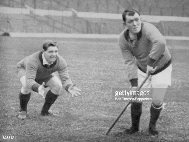 Manchester United's Sandy Turnbull right and Enoch 'Knocker' West photographed in 'cricketing' pose at Old Trafford in 1911