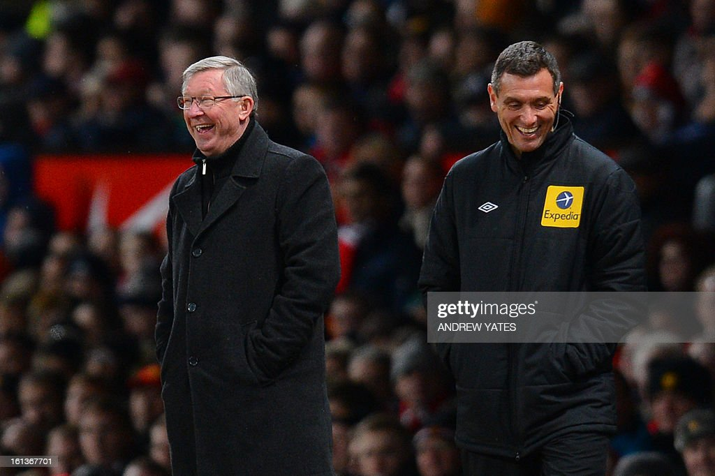 "Manchester United's Scottish manager Alex Ferguson (L) and fourth official Andre Marriner (R) share a joke during the English Premier League football match between Manchester United and Everton at Old Trafford, Manchester, North West England, on February 10, 2013. AFP PHOTO / ANDREW YATES USE. No use with unauthorized audio, video, data, fixture lists, club/league logos or ""live"" services. Online in-match use limited to 45 images, no video emulation. No use in betting, games or single club/league/player publications."