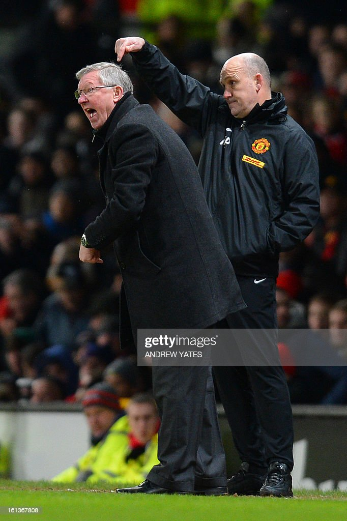 "Manchester United's Scottish manager Alex Ferguson (L) and Manchester United's assistant manager Mick Phelan (R) gesture from the touchline during the English Premier League football match between Manchester United and Everton at Old Trafford, Manchester, North West England, on February 10, 2013. USE. No use with unauthorized audio, video, data, fixture lists, club/league logos or ""live"" services. Online in-match use limited to 45 images, no video emulation. No use in betting, games or single club/league/player publications."