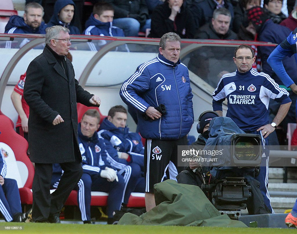 """Manchester United's Scottish manager Alex Ferguson (L) and Sunderland's Northern Irish manager Martin O'Neill (R) watch play during the English Premier League football match between Sunderland and Manchester United at the Stadium of Light in Sunderland, northeast England, on March 30, 2013. Manchester United won the game 1-0. USE. No use with unauthorized audio, video, data, fixture lists, club/league logos or """"live"""" services. Online in-match use limited to 45 images, no video emulation. No use in betting, games or single club/league/player publications. """""""