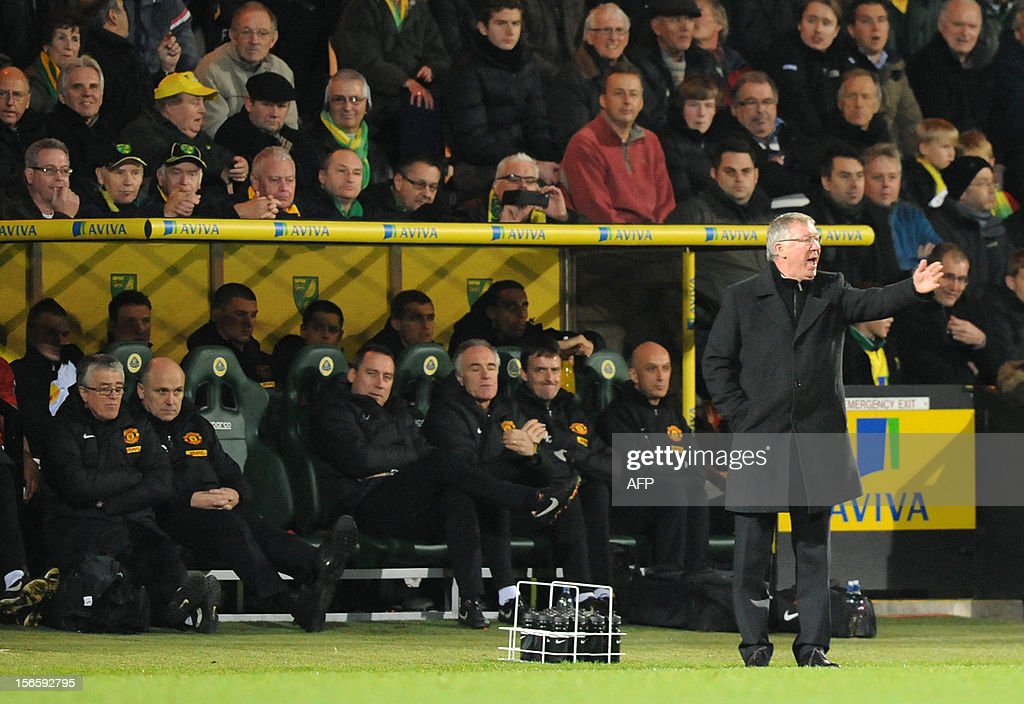 """Manchester United's Scottish manager Alex Ferguson (R) gestures during the English Premier League football match between Norwich City and Manchester United at Carrow Road stadium in Norwich, England on November 17, 2012. Norwich City won the game 1-0. USE. No use with unauthorized audio, video, data, fixture lists, club/league logos or """"live"""" services. Online in-match use limited to 45 images, no video emulation. No use in betting, games or single club/league/player publications."""