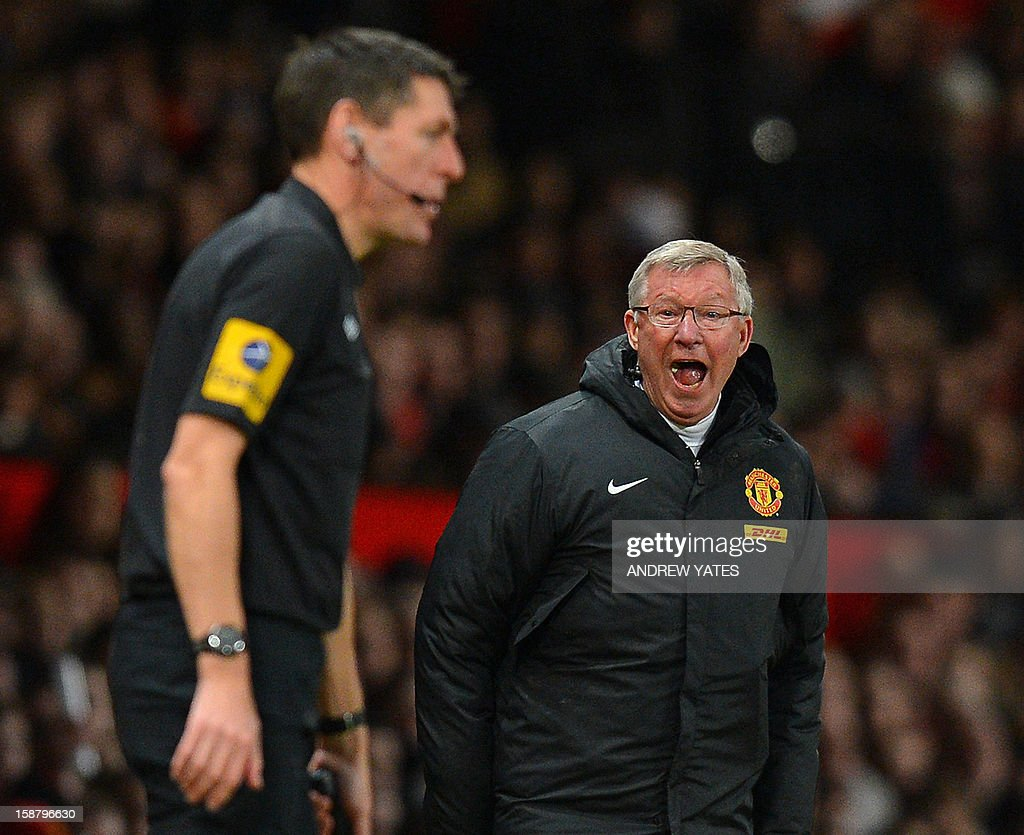 "Manchester United's Scottish manager Alex Ferguson (R) shouts at assistant referee Andy Garrett during the English Premier League football match between Manchester United and West Bromwich Albion at Old Trafford in Manchester, north-west England on December 29, 2012. Manchester United won the game 2-0. USE. No use with unauthorized audio, video, data, fixture lists, club/league logos or ""live"" services. Online in-match use limited to 45 images, no video emulation. No use in betting, games or single club/league/player publications"