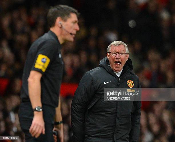 Manchester United's Scottish manager Alex Ferguson shouts at assistant referee Andy Garrett during the English Premier League football match between...