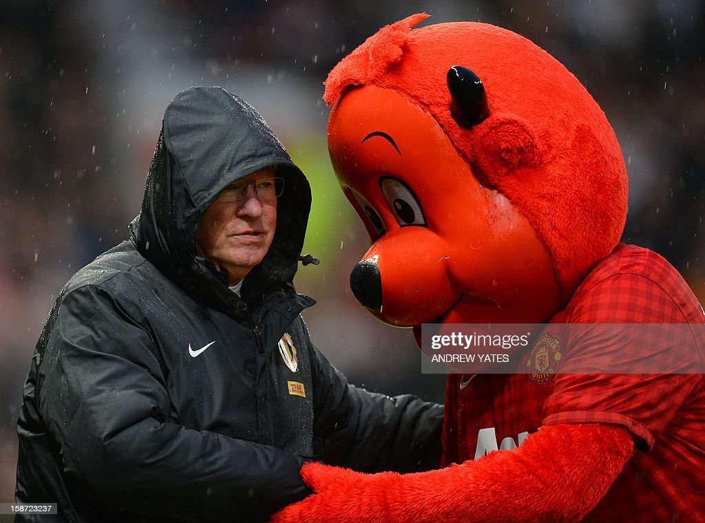 """Manchester United's Scottish manager Alex Ferguson (L) speaks to Manchester United mascot Fred the Red before the English Premier League football match between Manchester United and Newcastle United at Old Trafford in Manchester, north-west England on December 26, 2012. USE. No use with unauthorized audio, video, data, fixture lists, club/league logos or """"live"""" services. Online in-match use limited to 45 images, no video emulation. No use in betting, games or single club/league/player publications"""