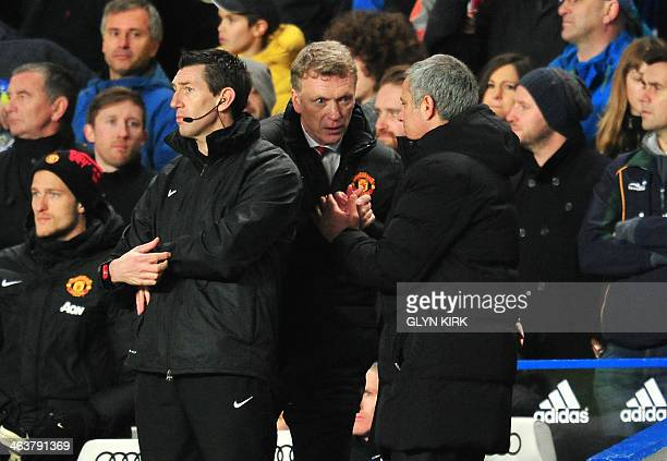 Manchester United's Scottish manager David Moyes and Chelsea's Portuguese manager Jose Mourinho shake hands at the end of the English Premier League...